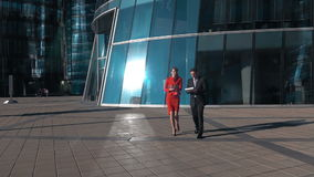 Business people walk in glass financial district. stock footage
