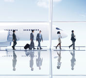 Business People Walking in the Airport Royalty Free Stock Images