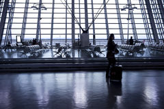 Business people walking in airport departure hall Stock Photos