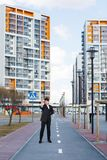 Business people walking along buildings Stock Photography