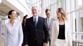 Business people walking along office building 62 stock video footage