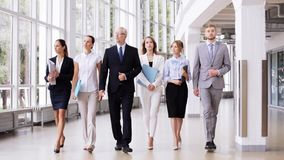 Business people walking along office building 1 stock video footage