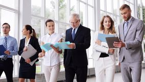 Business people walking along office building 14 stock footage