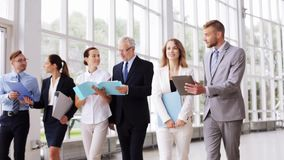 Business people walking along office building 11 stock footage