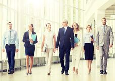 Business people walking along office building royalty free stock photo