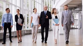 Business people walking along office building 6 stock video footage