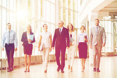 Business people walking along office building Stock Photo