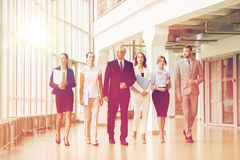 Business people walking along office building Stock Image