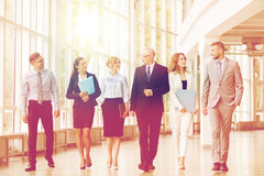 Business people walking along office building Stock Photography