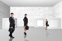 Business people walking on art gallery Stock Images