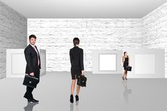 Business people walking on art gallery Stock Photography