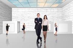 Business people walking on art gallery Stock Photo