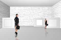 Business people walking on art gallery Stock Image