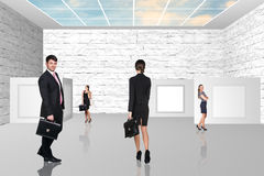 Business people walking on art gallery Stock Image