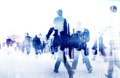 Business People Walking on a City Scape Stock Images