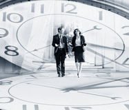 Business people walking on a clock background Royalty Free Stock Photography