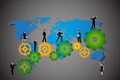 Business People walking on cog wheel Stock Image