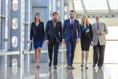 Business people walking the corridor royalty free stock photography