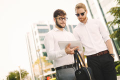 Business people walking and discussing news stock photo