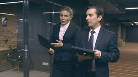 Business people walking and discussing project. In hall of business center stock footage
