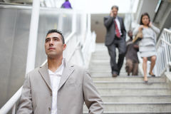 Business people walking down the stairs Royalty Free Stock Photography