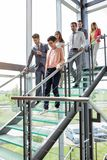 Business people walking down stairs royalty free stock images