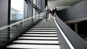 Business people walking down the stairs stock video footage