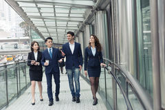 Business people walking. Group of business people walking at street Royalty Free Stock Images