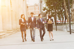 Business people walking. Group of business people walking at street Royalty Free Stock Image