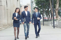 Business people walking royalty free stock photo
