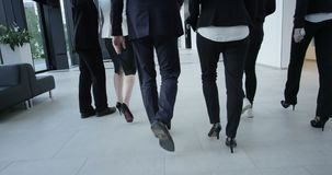 Business people walking in hall stock video footage