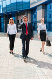 Business people walking i. N modern city downtown Royalty Free Stock Photography