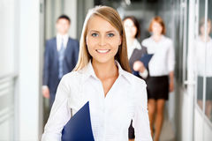Business people walking. In the office corridor Royalty Free Stock Photo