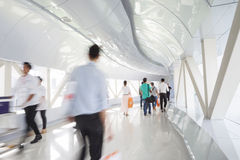 Business people walking in the office corridor. Royalty Free Stock Photo
