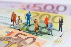 Business People Walking On Paper Money Stock Image