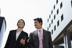 Business People Walking Outdoors Stock Photo