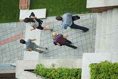 Business people walking overhead view Stock Photography