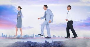 Business people walking on rope stock photography