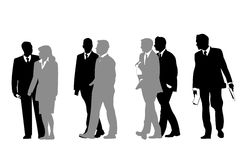 Business people walking silhouettes Stock Images