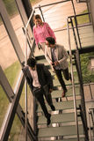 Business people walking on the stairs. Business people walking on the stairs and having discussion. Business people in business building Stock Image