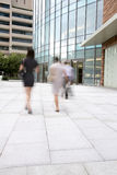 Business people walking in the street Royalty Free Stock Photos