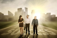 Business people walking on success word Royalty Free Stock Images