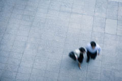 Business people walking. And talking in the street, high angle view Stock Photos