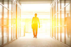 Business people walking thru modern office Stock Photos