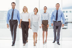Business people walking together in office Royalty Free Stock Images