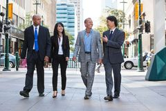 Business people walking together on street stock photography