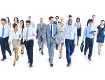 Business People Walking Toward Camera Stock Image