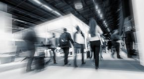 International Trade Show. Business people walking at trade show booths, abstract zoom in effect. ideal for websites and magazines layouts royalty free stock images