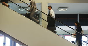 Business people walking up the stairs stock video footage