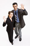 Business people waving. Two business people waving towards the camera Stock Photos
